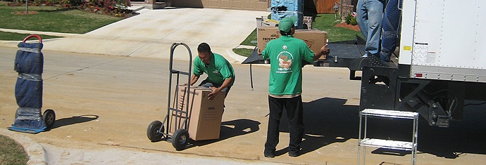 Green Van Lines movers working on a truck