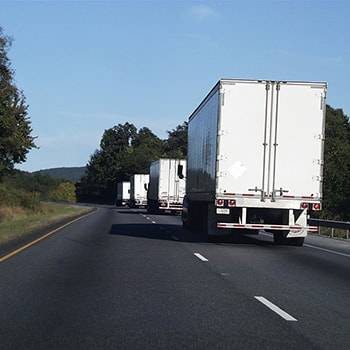 Trucks Driving on the Road